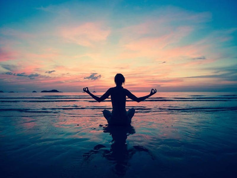 image of lady sitting in water meditating